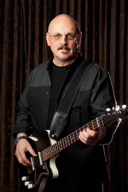 Bruce Jacobs (Bass guitar, backing vocals)